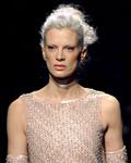 US model Kristen McMenamy presents a cre
